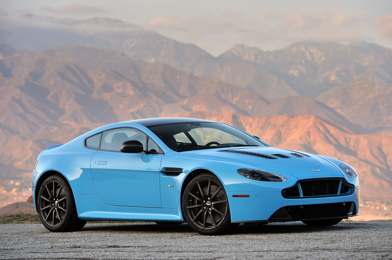 aston v12 vantage s against jaguar xkr-s gt in battle of the brits